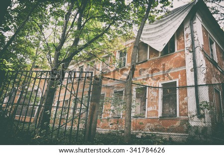 Old abandoned building in forest area. Toned photo - stock photo