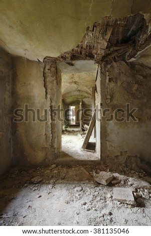 Old abandoned corridor in an ancient villa. - stock photo