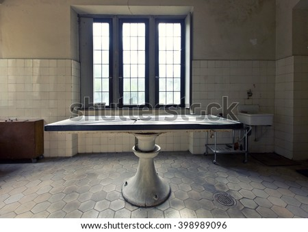 Old abandoned dissecting table - stock photo