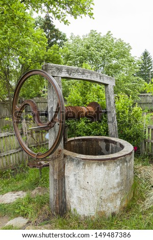 Old abandoned drought rusty draw well. Summer drought. Water crisis. - stock photo