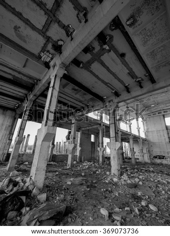 Old abandoned factory in black and white.