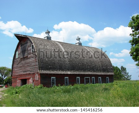 old abandoned farm buildings red barn - stock photo