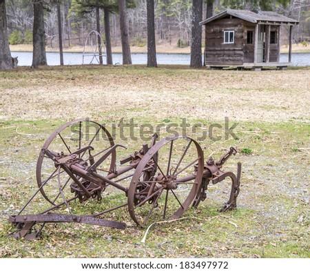 Old abandoned farm Equipment  - stock photo