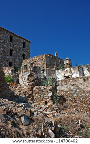 Old abandoned Greek/Turkish village of Doganbey, Turkey - stock photo