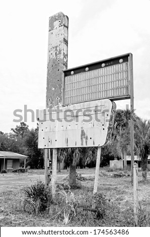 old abandoned hotel motel buildings in the pan handle of Florida near swamp land of the Gulf of Mexico - stock photo