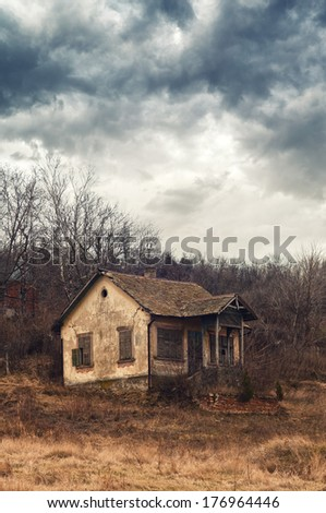 Old abandoned house. Crumbling old house in rural field in North Serbia. - stock photo