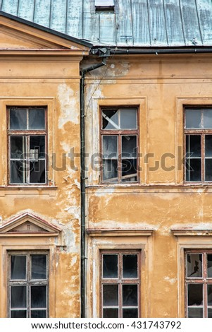 Old abandoned house in Banska Stiavnica, Slovak republic. Architectural theme. Ancient house. Ruin house. Cracked wall. Impaired statics. Old architecture. Broken windows. - stock photo