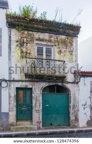 Old abandoned house in Ponta Delgada, Azores, San Miguel island (Sao Miguel) - stock photo