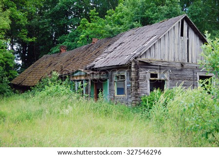 old abandoned house in the trees