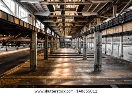 Old abandoned industrial interior - stock photo