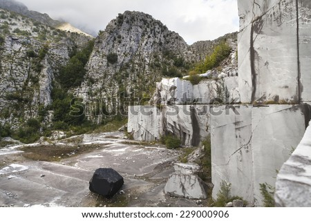 Old abandoned marble mine in Italy - stock photo