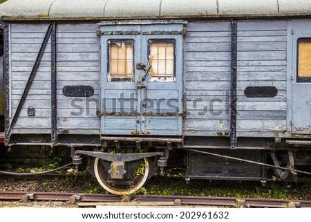 Old abandoned railway carriage - stock photo