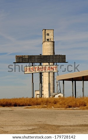Old abandoned restaurant or cafe sign along Route 66 in northern Texas - stock photo