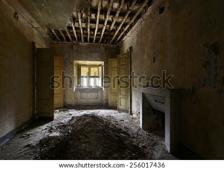 old abandoned room with window and fireplace - stock photo