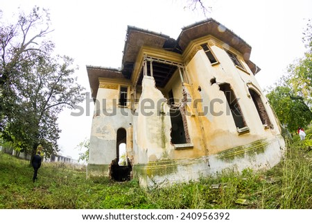 Old, abandoned, ruined house with beautiful details. Fish eye lens effect - stock photo