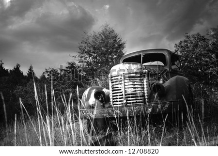 Old Abandoned Rusted Truck Grayscale - stock photo