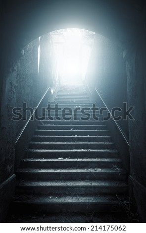 Old abandoned stairs going up to the light. Hope concept - stock photo