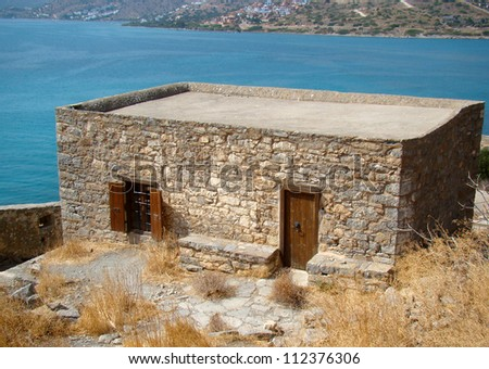 Old abandoned stone house on the island of Spinalonga, Crete