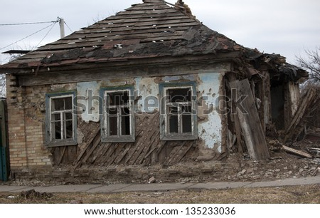 old abandoned wooden house on the street - stock photo
