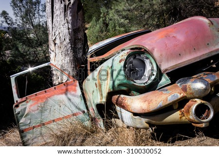 Old abandoned wrecked car - stock photo