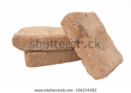 Old adobe bricks - used and recyclable building materials - stock photo