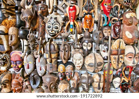 Old african masks for sale at market in Nairobi, Kenya. Africa. - stock photo