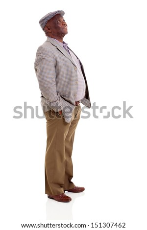 old afro american man looking up with hands in pockets - stock photo