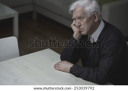 Old age man feel lonely and depressed - stock photo