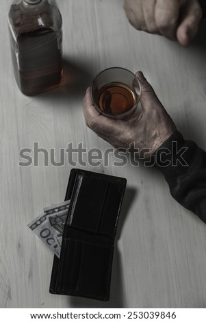 Old aged divorcee falls into an alcoholism - stock photo