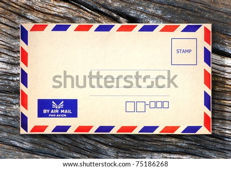 Old air envelope on wooden background - stock photo
