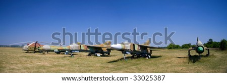 Old airfield with a military aircraft in Ukraine - stock photo