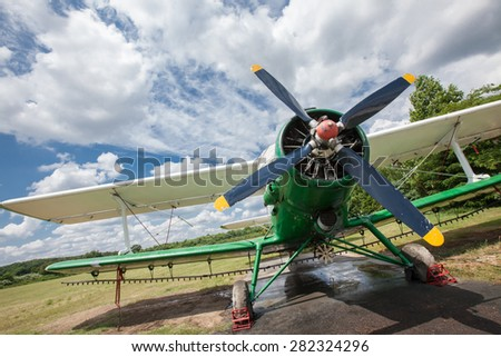 old airplane against a cloudy sky - stock photo
