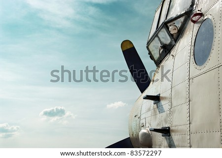 Old airplane sideview - stock photo