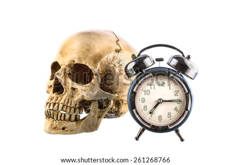 Old Alarm clock and  human skull on white background - stock photo