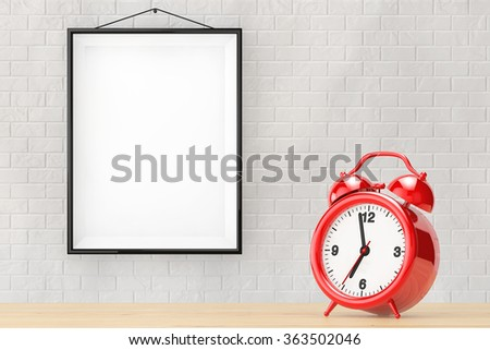 Old Alarm Clock in front of Brick Wall with Blank Frame extreme closeup - stock photo