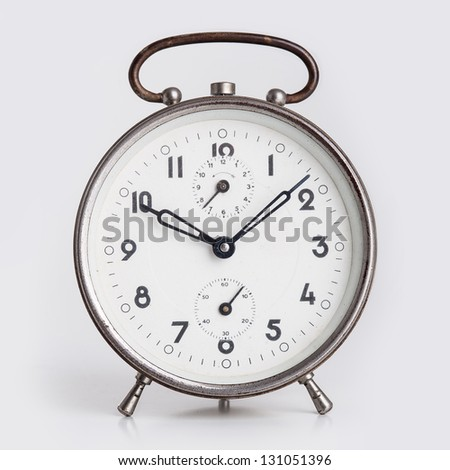 Old Alarm Clock isolated on white background.