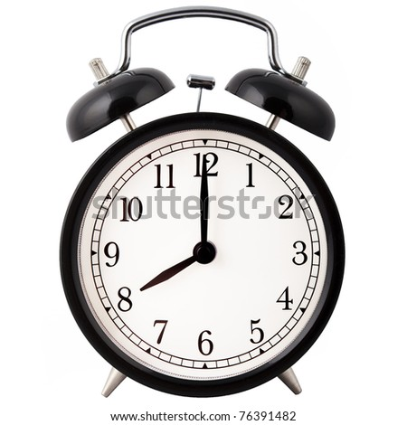 Old Alarm Clock isolated on white, in black and white, showing eight o'clock.