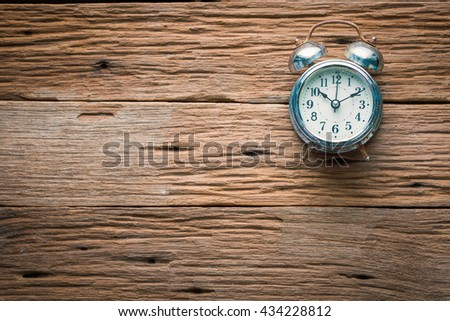 Old alarm clock on wooden background. Deadline or start time top view background with copy space - stock photo