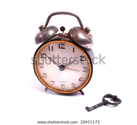 old alarm-clock with a key