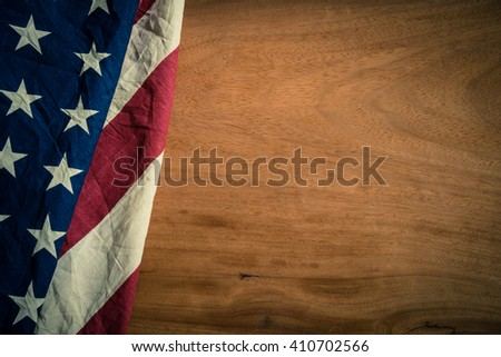 Old American flag on wood background for Memorial Day or 4th of July or Dependence Day - stock photo