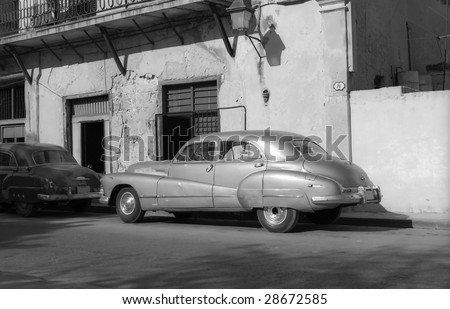 Old American vintage car on a street in Havana Cuba - stock photo