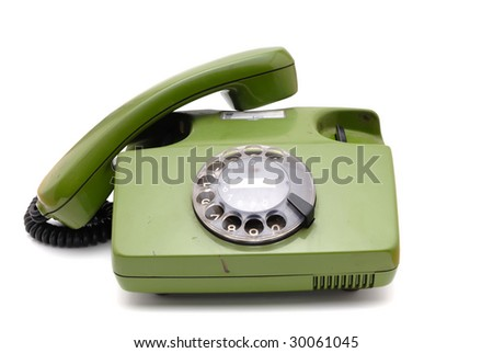 Old analogue disk phone on a white background - stock photo