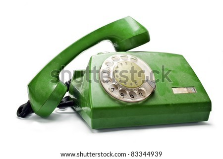 Old analogue disk phone on a white background