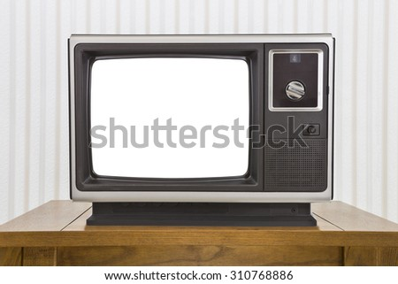 Old analogue portable television on table with cut out screen. - stock photo