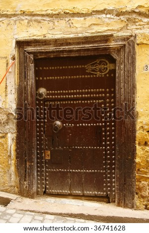 Old ancient door to a arabic home. Medina (old town) of Fes, Morocco. - stock photo