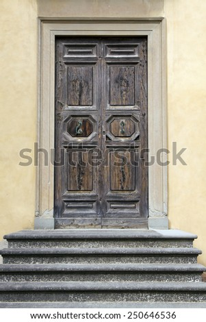 Old ancient wooden door with stairs - stock photo