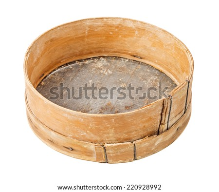 Old ancient wooden sieve isolated on white background - stock photo