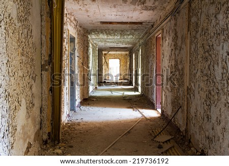 Old and abandoned corridor of a building - stock photo