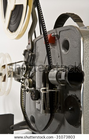 Old and antique commercial film projector - stock photo