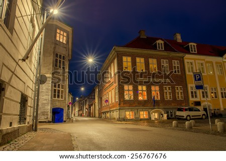 old and beautiful streets of the city at night - stock photo